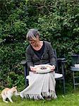 Woman holding an apple-pie, Sweden.