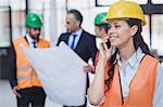 Confident female architect talking on mobile phone