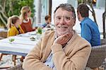 Portrait smiling senior man enjoying patio lunch with family