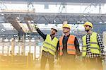 Steel workers talking in factory