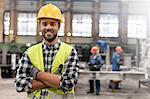 Portrait smiling confident steel worker in factory