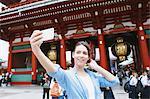 Caucasian woman enjoying sightseeing in Tokyo, Japan