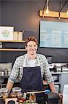 Portrait confident cafe owner at cash register