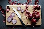 Fresh red onions sliced on cutting board