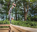 Boy doing handstand on handrail
