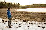 Mid adult man standing beside lake, looking at view, Flagstaff, Arizona, USA