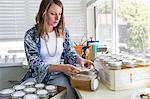 Women labelling jars