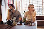 Man ignoring woman while talking on phone