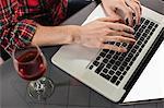 Man using laptop in bar