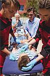 Paramedics examining injured boy