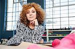 Portrait of mature female fashion designer in workshop