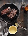 Sirloin steak in frying pan with bearnaise sauce