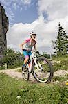 Mountain biker riding on uphill, Kampenwand, Bavaria, Germany