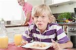 Portrait of a boy eating spaghetti, Bavaria, Germany