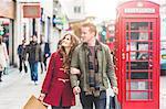 Couple on shopping spree, London, UK