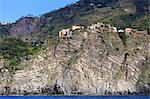 Colourful houses and cliffs atop rocky promontory, Corniglia, Cinque Terre, UNESCO World Heritage Site, Ligurian Riviera, Liguria, Italy, Europe