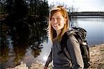Woman hiking beside lake