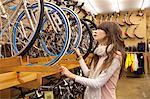 Woman Shopping for Bike in Bike Shop