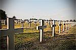 Unmarked cross headstones in graveyard