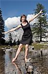 Smiling woman playing in lake