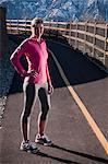 Runner standing on rural road