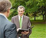 Businessmen using tablet computer