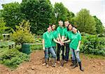Gardeners posing together in park