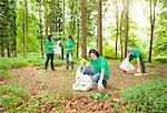 Gardeners picking up trash in park