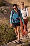 Hikers walking on dusty hillside