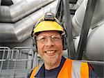 Worker wearing hard hat in factory