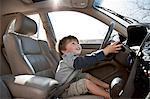 Little boy pretending to drive car