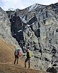 Trekker hiking a ridge in Yak Kharka, Nepal