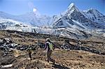 Trekkers beginning day hike, Chhukung, Nepal