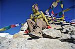 Female trekker on the summit of Kala Patthar, Chhukung, Nepal