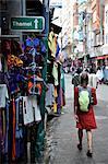 Woman tourist walks down the street of Thamel in Kathmandu, Nepal