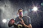 American footballer preparing to throw ball