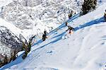 Female skiing down mountain