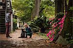 Couple with dog behind house, Savannah, Georgia, USA