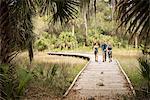 Hikers on walkway, Skidaway Island State Park , Savannah, Georgia, USA