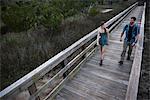Hikers crossing bridge, Skidaway Island State Park , Savannah, Georgia, USA