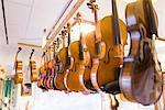 Violins in violin maker's production studio