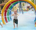 Boy running through swimming pool, Botanical Gardens, Singapore