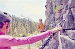 Couple rock climbing, Ehrwald, Tyrol, Austria