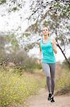 Jogger running in park, Stoney Point, Topanga Canyon, Chatsworth, Los Angeles, California, USA