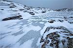 Rocky coast and frozen sea