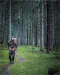 Man hiking through forest