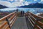 Two visitors at Perito Moreno Glacier in the Parque Nacional de los Glaciares (Los Glaciares National Park), UNESCO World Heritage Site, Patagonia, Argentina, South America