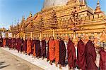 Monks at the Shwezigon Pagoda, Bagan (Pagan), Myanmar (Burma), Asia