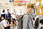 Caucasian tourist boarding a train, Tokyo, Japan