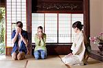Caucasian couple enjoying tea ceremony at traditional Japanese house